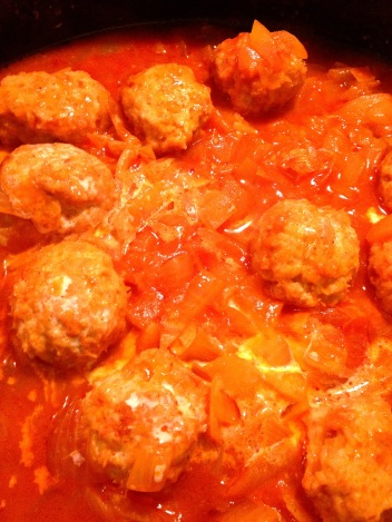 Adding a touch of cream to simmered meatball curry