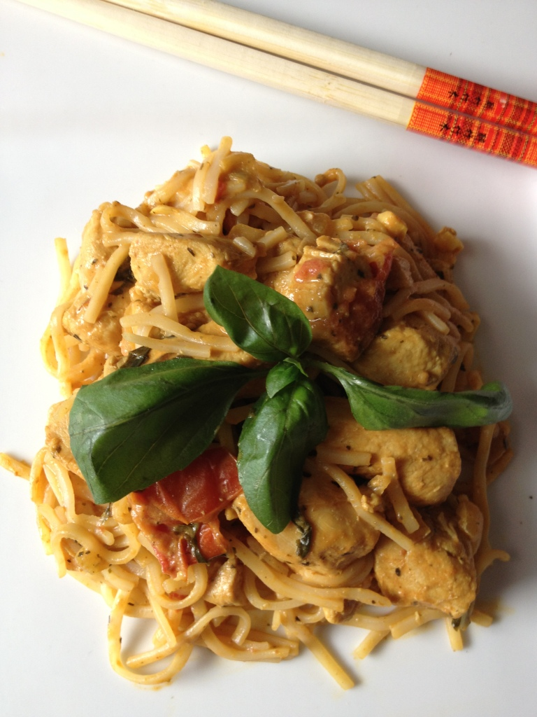 Thai peanut chicken curry with coconut milk, plum tomatoes, and fresh basil