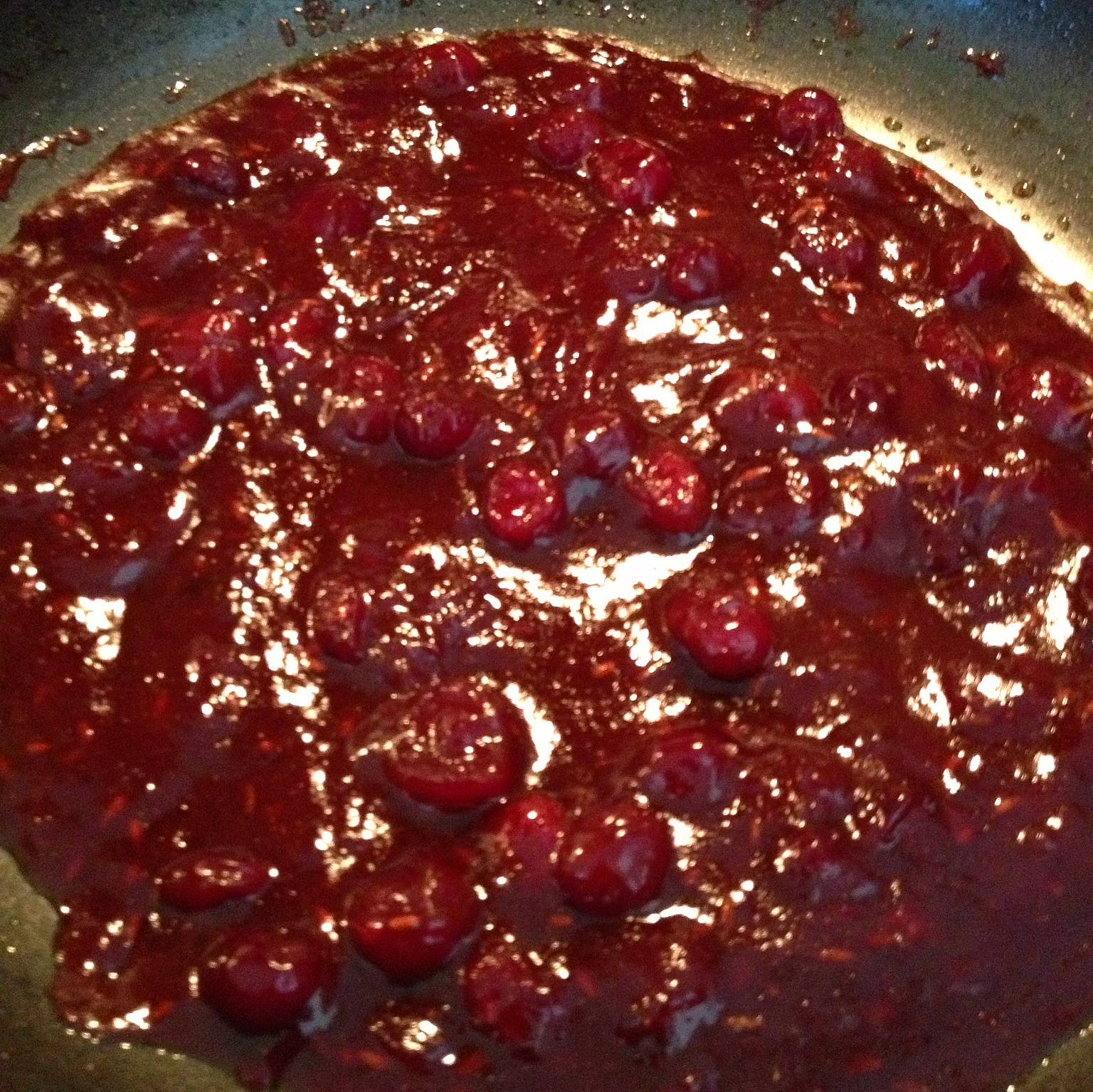 Simmering cranberry chutney with spices