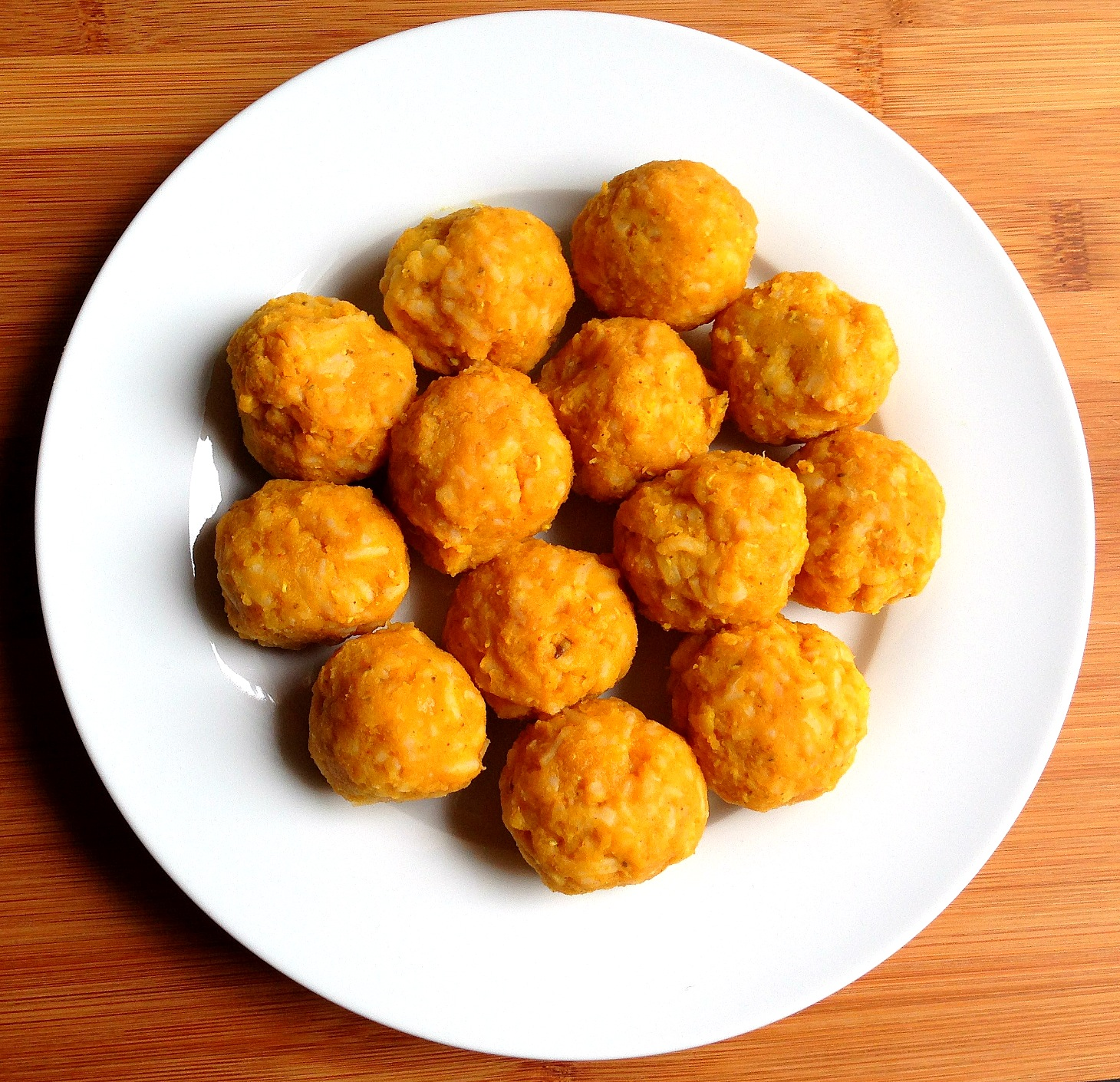 Plate of soft lentil & rice balls for toddlers